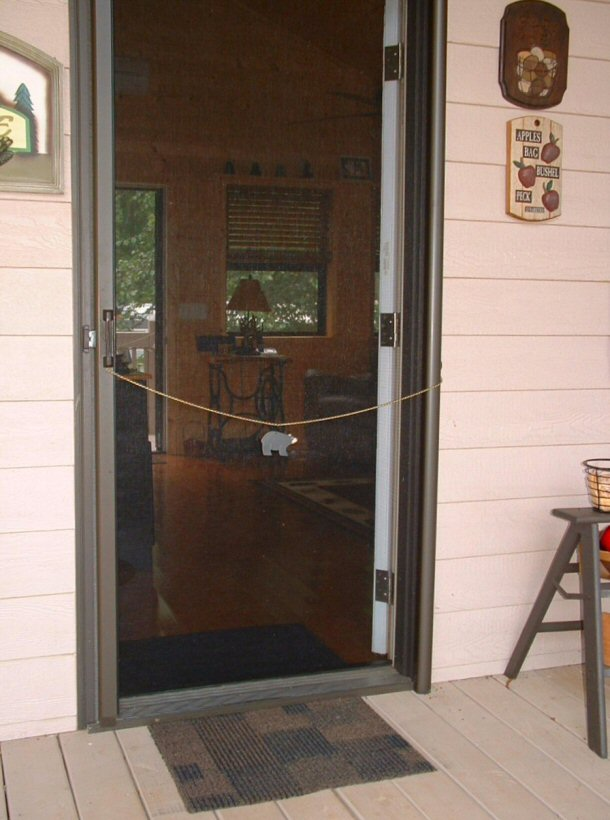Retractable screen door collision avoided
